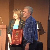 Mona Nemer receives the Arthur Wynne Gold Medal from Phil Hieter in Banff